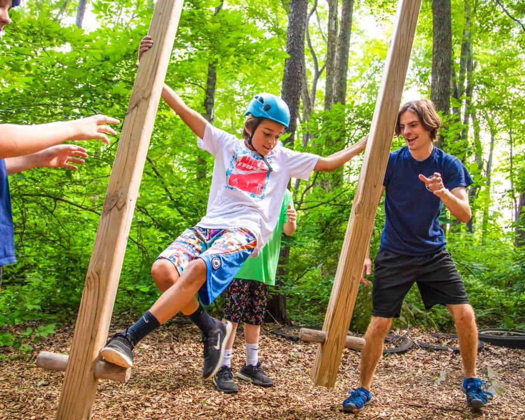 Camper crosses challenge on low ropes course