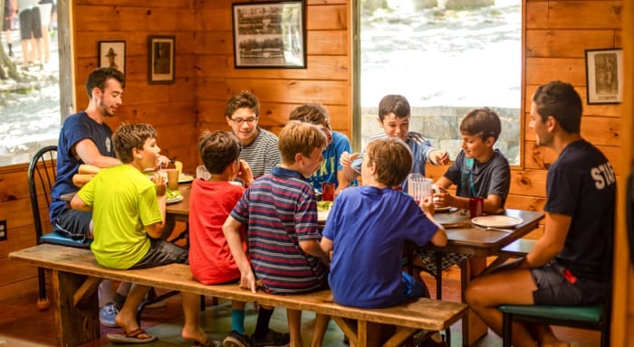 Camp Awosting boys eat dinner in dining hall