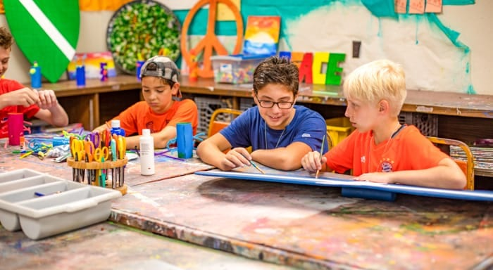 Boys make art at summer camp