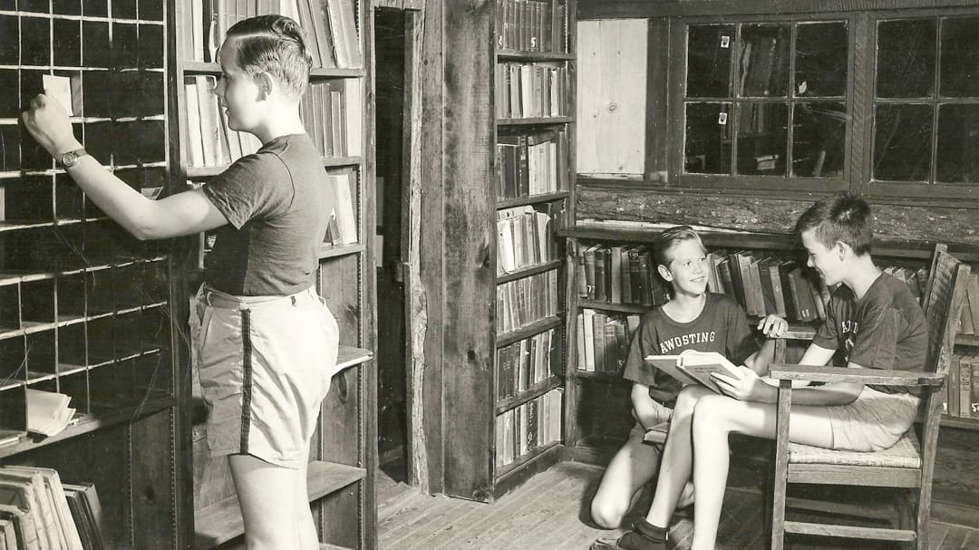 Historical photo of Awosting campers reading